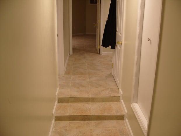 Casual comfortable basement in jacksonville beige tile for Hardwood floors jacksonville nc