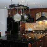 Traditional Kitchen with stainless steel stove hood