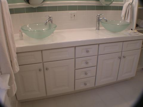 Traditional Master Bathroom with whtie raised panel cabinets