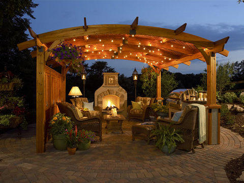 Traditional Patio with fire place and kitchen area under trellis