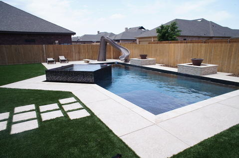 Modern Pool with grass between concrete steps
