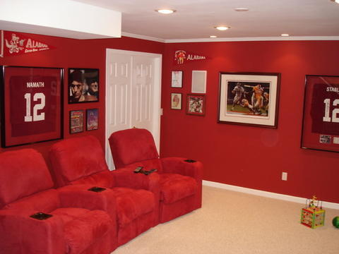 Eclectic Home Theater with red suede theater chairs