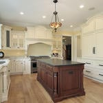 Traditional Kitchen with kitchen island with dark wood cabinets