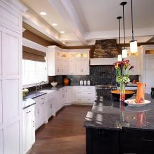 Transitional Kitchen with large kitchen island with black cabinets