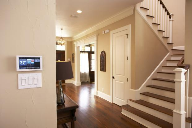 Traditional Entry with sophisticated thermostat