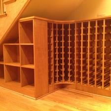 Modern Wine Cellar with wood stairs and railing