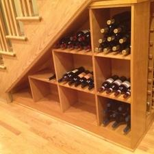 Modern Wine Cellar with built in under stairs shelf