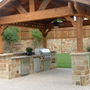 Lodge Outdoor Kitchen with exposed aggregate cement patio