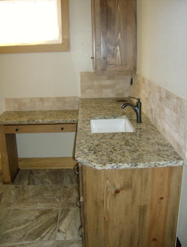 Southwestern bathroom in sulphur stone subway tile for Southwestern flooring