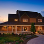 Casual / Comfortable Home Exterior with white exterior trim paint