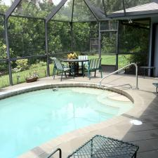 Traditional Sunroom with large sun room with in ground pool