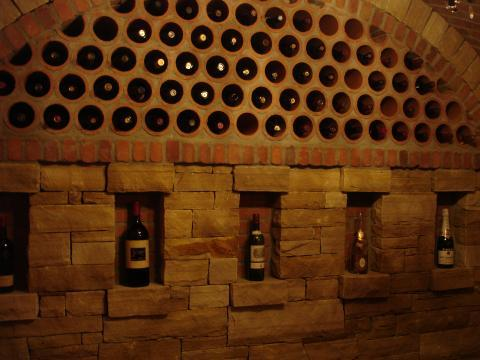 Traditional Wine Cellar with below round holes a row of boxed space for wine stand