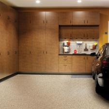 Contemporary Garage with medium wood stained cabinets