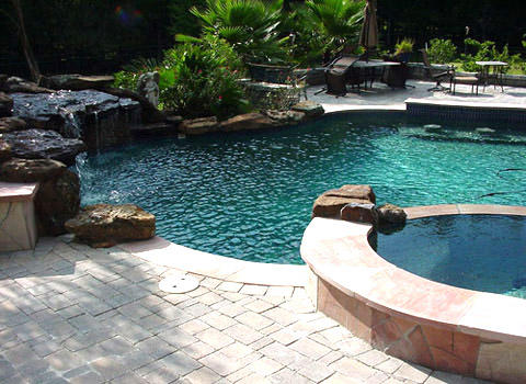 Transitional pool in spring natural stone natural by for Outdoor furniture 77386