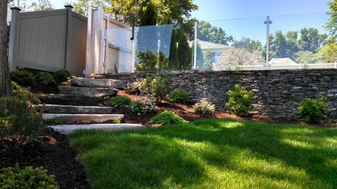 Modern Landscape with stacked stone retaining wall