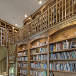 Traditional Library with brass bookshelf lighting