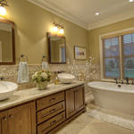 Casual / Comfortable Bathroom with natural wood recessed panel cabinets