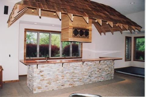 Traditional Bar with roof inside over bar area