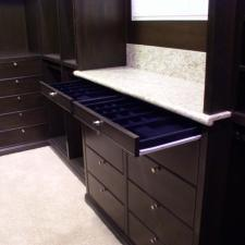Traditional Closet with pull out drawers with organized sections