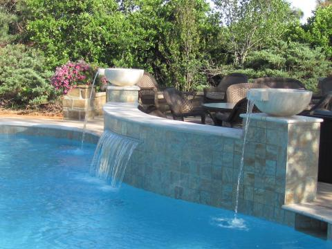 Transitional Pool with large cement water fall feature bowls