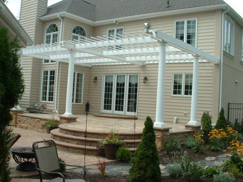 Transitional Patio with white columns around patio
