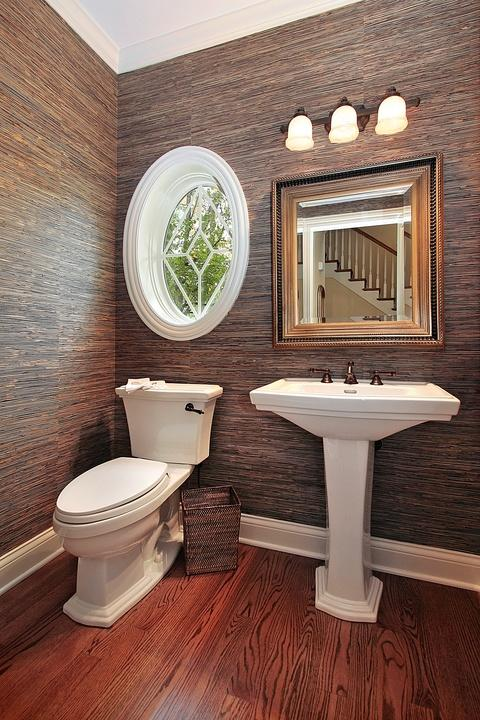 Traditional Bathroom with oil rubbed bronze light fixture