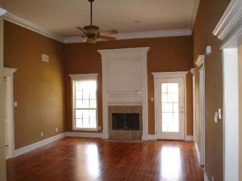 Traditional Family Room with white framed doors and windows