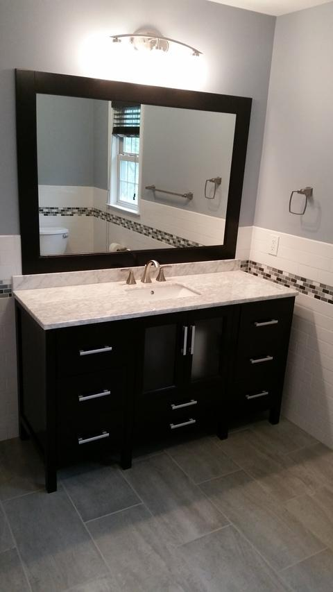 Contemporary Bathroom with frosted glass front cabinet doors