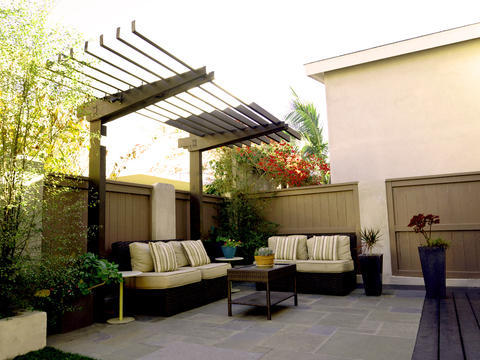 Contemporary Patio with brown composite fence