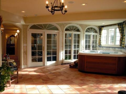 Traditional Sunroom with white wood doors with glass panels