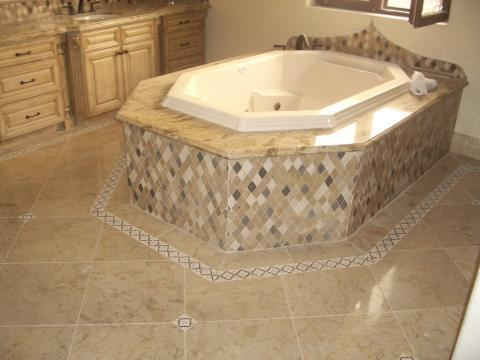 Traditional Master Bathroom with granite tub surround
