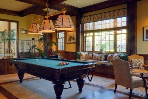 Traditional Family Room with large hanging pool table lights