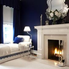 Transitional Bedroom with beautiful elegant mirror above fire place mantel