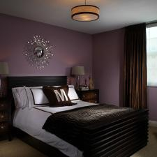 Transitional Bedroom with dark purple painted walls