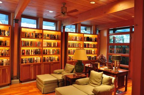 Contemporary Library with green upholstered lounge chairs