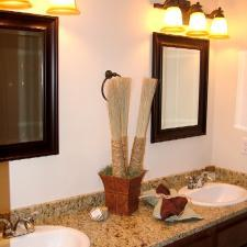 Traditional Master Bathroom with three light wall sconce