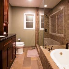 Contemporary Master Bathroom with glass shower stall door and walls