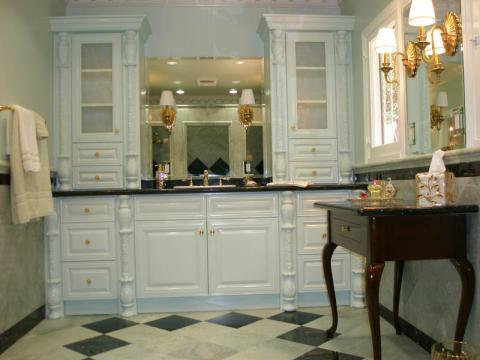 Traditional Master Bathroom with frosted glass front cabinet doors