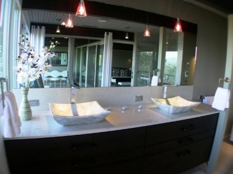 Contemporary Master Bathroom with frame less mirrors