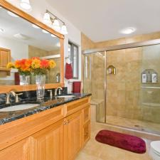 Traditional Master Bathroom with light wood stained vanity cabinet