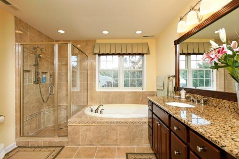 Traditional Bathroom with white trim windows with white moulding