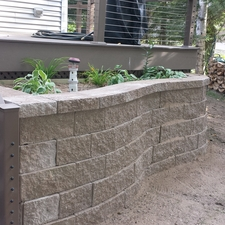 Modern Landscape with gray engineered retaining wall blocks