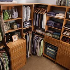 Traditional Closet with raised panel wood cabinets and shelving