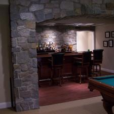 Traditional Basement with black leather bar stools