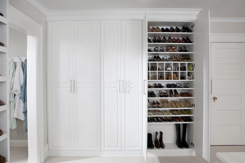 Cape Cod Closet with white cabinet crown molding