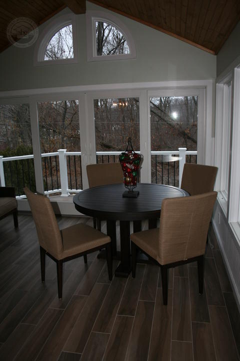 Traditional Sunroom with beige upholstered dining chairs