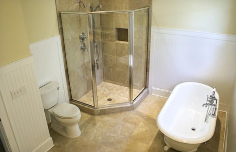 Traditional Master Bathroom with glass shower walls