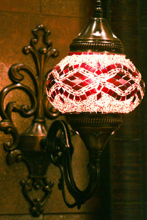 Eclectic Bathroom with hand beaded wall sconce