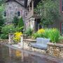 Cottage Driveway with stacked stone retaining walls