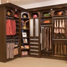 Traditional Closet with small built-in closet cabinet lighting